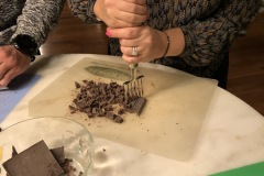 chopping chocolate bars with a chipper