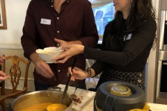 Birthday  girl serving soup