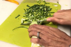 chopping leeks for risotto