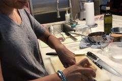 shaving parmesan cheese for porcini mushroom sauce